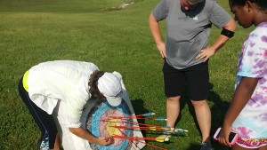 Weber reviewing Carey Miller's top score of 87xx.  Miller is active in the Sundance Apt. Community as the manager where archery is sponsored.  She believes everyone should take advantage of opportunities and she certainly has taken a Top Shot at this one!